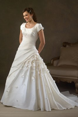 BRIDAL CORNER GOWNS & TUXEDOS