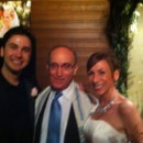 130x130 sq 1425867604636 a beautiful bride and groom stand with rabbi david