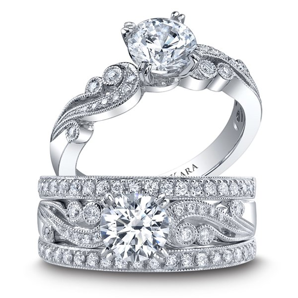 <b>Angelique collection 1250DC-R & 1250D-B</b> <br><br> Handcrafted engagement ring from the Angelique collection crafted with 0.14 carats of diamonds (center stone not included). Shown with two matching wedding bands, each crafted with 0.19 carats of diamonds.
