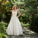 Bernadette Bernadette's airy elegance is far from ordinary. This silk dupioni ball gown's French Alencon lace illusion V-neckline, drop waist and finely gathered ball gown skirt have a splendid, gracious sensibility! Luscious Swarovski crystal and pearl beading accents the waist.