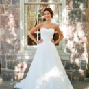 Bella Bella is romantic. This flowing, A-line wedding gown, layered with silk Organza, English Net and hand-cut lace appliqué has a lovely, rich quality. A gently draped bodice, finished with a delicate corsage, makes Bella truly a beauty!