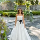 Willow A modern belle of the ball, silk dupioni Willow's lavish, gathered skirt and sweetheart bodice create a wedding gown with a striking silhouette. Crowned with a touch of French Alencon lace, a textured sash and pockets, Willow is a subtle stunner!