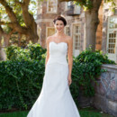 Quin A fluted silhouette, draped waist, and lush bodice of beaded French Alencon lace render this wedding gown unforgettable. Gilded with a lace-edged hem and covered buttons, Quinn's is a timeless beauty! Shown in off white dupioni with off white lace.