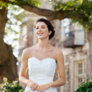 Quinn A fluted silhouette, draped waist, and lush bodice of beaded French Alencon lace render this wedding gown unforgettable. Gilded with a lace-edged hem and covered buttons, Quinn's is a timeless beauty! Shown in off white dupioni with off white lace.