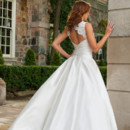 Emily Like classic beauties of the silver screen, silk dupioni Emily is unforgettable. Crafted from rich French Alencon lace, this gown's bateau neckline enhances its timeless, A-line silhouette, while a lovely keyhole back beguiles.