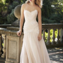 Alice Layers of beaded French Alencon lace applique and silk organza form the bodice of this peony-pretty wedding gown. A soft, flowing skirt of silk chiffon and silk organza falls from the drop waist.