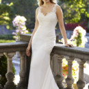 Angelina Sheer French Alencon lace straps frame the deep V-back and decollete of this tempting silk crepe wedding gown. Overlaid in lace applique, Angelina's shaped bodice falls into a fluid skirt.
