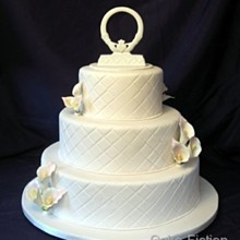220x220 sq 1310181514361 quiltedivoryweddingcakewithcallalillies