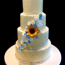 220x220 sq 1509937313188 gold wedding cake with ivory lace and sunflower