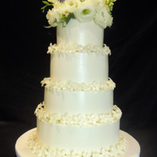 220x220 sq 1509937966982 buttercream wedding cake with fresh stephanotis an