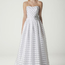 Dorothy / 279FB Strapless wedding dress with gathered skirt. Layered striped organza creates an optical illusion of a gingham pattern. Constructed with garment boning in front and back for a more secure fit. Accessorized in our metallic silver flower (sold separately). Fully lined. Made in USA. Dress as pictured: $998