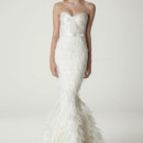 Ella Sweetheart neckline strapless wedding gown, featuring a corset top and feather skirt. Made in USA.