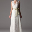 Madison / 286FA V-neck wedding dress in an A-line silhouette. Scalloped edges around neckline, armholes and hem of dress. Shown in our ivory embroidered lace. Accessorized with our basic sash (sold separately) in jade duchess satin. Fully lined, Made in USA. Dress as pictured: $975 Only available in embroidered lace.