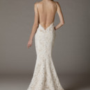 Jillian / 282 V-neck wedding dress in a fitted mermaid silhouette. This beautiful gown features an alluring low back design. Scalloped edges around neckline, armholes and hem of dress. Shown in our ivory embroidered lace and champagne satin lining (Matching ivory lining also available). Fully lined, made in USA. $1,200