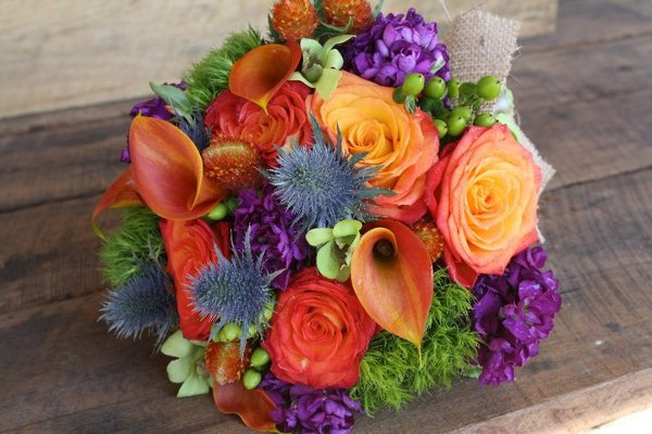 how to decorate a wedding cake with artificial flowers blue green orange purple bouquet fall summer wedding 15665