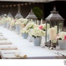 130x130 sq 1460571171751 centerpiece   long table with lanterns milk glass