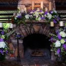 130x130 sq 1361895111728 flowersonmantelwideshot
