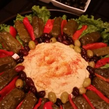 220x220 sq 1451399659098 hummus with stuffed grape leaves and roasted peppe