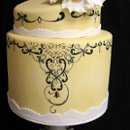 130x130_sq_1280698814603-yellowdrawnflowerweddingcakemed