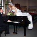 130x130 sq 1232393317328 piano