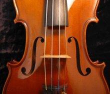 220x220 1241995796703 violintopviewcloseup