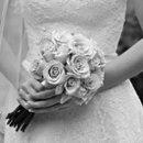 130x130_sq_1233794603207-holdingflowers