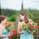 130x130_sq_1306418815084-bridesmaidslaughingduringweddingceremony2
