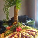 130x130 sq 1347478883931 pineapplepalmtreefruitdisplay