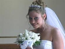 220x220 1393347386497 bride peeks at vide