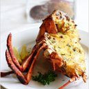 130x130 sq 1234074535582 baked lobster