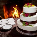 130x130 sq 1347046383574 cakeinfrontoffireplace