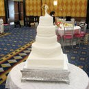 130x130_sq_1268076222854-weddingcake19