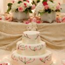 130x130 sq 1234805729226 weddingcakewithcandles