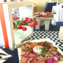 130x130 sq 1487782938774 charcuterie on buffet  chevron and tulips  orange