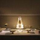 130x130 sq 1473829452883 75 gold  white wedding cake