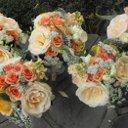 130x130 sq 1279147506806 peachwildflowerbridesmaidsbouquets