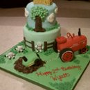 130x130 sq 1284474025794 tractorcake