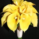 A petite bridal bouquet of sunny yellow, faux calla lilies.