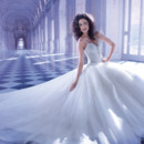 Ilissa Style 561 Jewel encrusted beaded tulle ball gown wedding dress with a V-neckline and spaghetti straps. Bridal gown features a lace-up back and attached Chapel train.