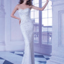 Ilissa Style 563 Jewel encrusted strapless, Sheath wedding gown with a soft Sweetheart neckline. This bridal dress also features a wrap-around, detachable tulle train.
