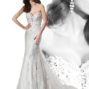Ultra Sophisticates Style 1455 Beaded Venice lace fit n flare, strapless wedding gown with a Sweetheart neckline and buttons on back. This bridal dress features an attached Chapel train. Beaded belt sold separately.