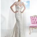 Ultra Sophisticates Style 1461 Strapless, beaded lace wedding gown with a Sweetheart neckline and lace-up back. This bridal dress features a Trumpet skirt and Chapel length train. Cape sold separately.
