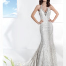 Ultra Sophisticates Style 1463 Beaded lace, Halter, fit n flare wedding gown with a jeweled neckline. This bridal dress has a Chapel length train.