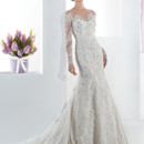 Ultra Sophisticates Style 1468 Beaded lace fit n flare wedding gown with a high sheer neckline and long sheer lace sleeves. This bridal dress also features a low sheer back with buttons and Chapel length train.