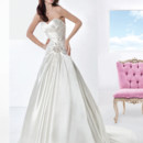 Illusions Style 3201 Crystal Organza, A-line wedding gown featuring a Sweetheart bodice with lace-up back, asymmetrical inverted pleats and beaded motif on waist. The skirt on this bridal dress is finished with a Chapel length train.