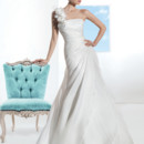 Illusions Style 3202 Satin Organza, A-line wedding gown with flowers on one-shoulder and asymmetrical pleating on bodice. The skirt on this bridal dress features a side split with ruffles and attached Chapel train.