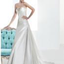 Illusions Style No. 3208 Taffeta, Strapless, A-line wedding gown with a beaded Sweetheart neckline, wrapped bodice with asymmetrical pleating and lace-up back. The skirt on this bridal dress features a wrapped side split and Chapel length train.
