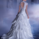 Sposabella Style No. 4315 Satin, A-line wedding gown with a beaded lace bodice featuring a Sweetheart neckline cap sleeves and high lace keyhole back. This bridal dress also features a pleated wrap waist and split bustled skirt with tulle and lace underlay. Back is finished with buttons and attached bustled skirt.