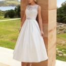 Destination Romance STYLE DR194 Sleeveless, A-line, Cocktail length dress featuring a Taffeta skirt and Alencon lace bodice with a sheer neckline and belt with jeweled appliqué on waist.
