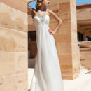Destination Romance DR196 Chiffon, A-line destination wedding gown with a ruched Empire bodice with beading and jeweled halter Strap. The skirt on this bridal dress features a Sweep train.